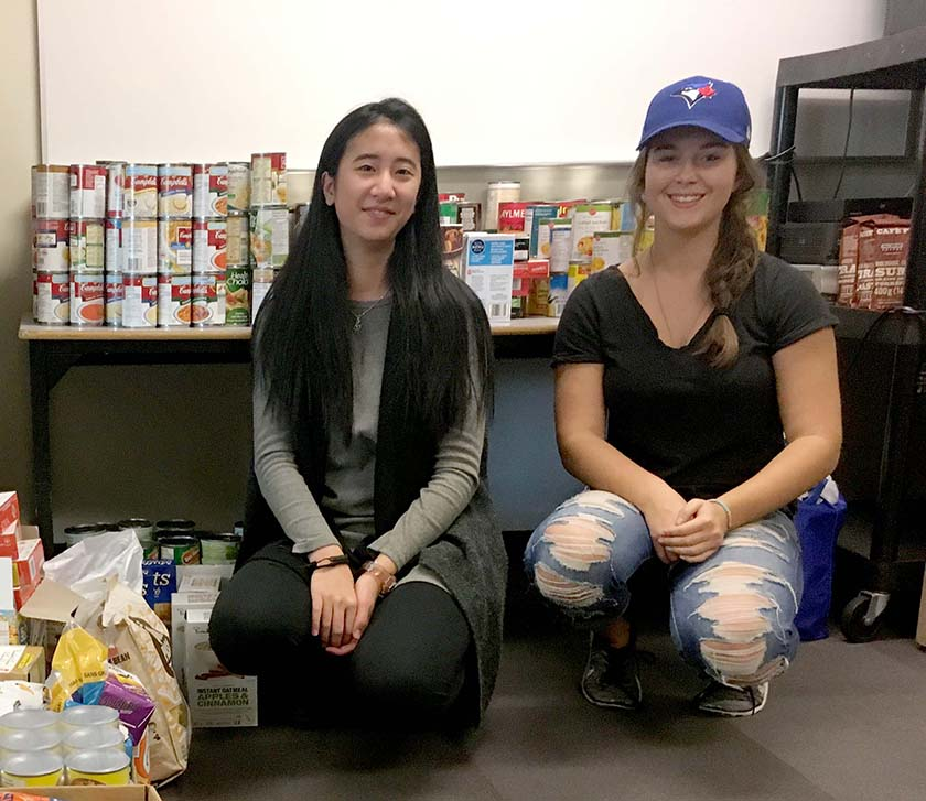 Taylor Ko and Alyssa Cable helped collect and sort the food for Rebels for a Cause.